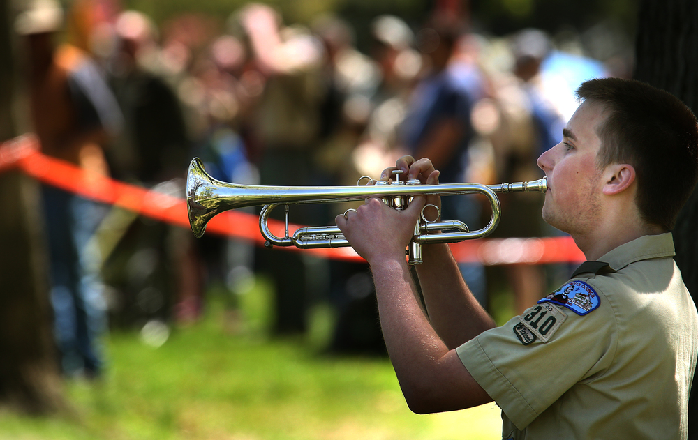 Playing taps at the end of the wreath-laying ceremony Sunday was Brandon Coonrod, 16, a Life scout from Chatham troop #310.  David Spencer/The State Journal-Register