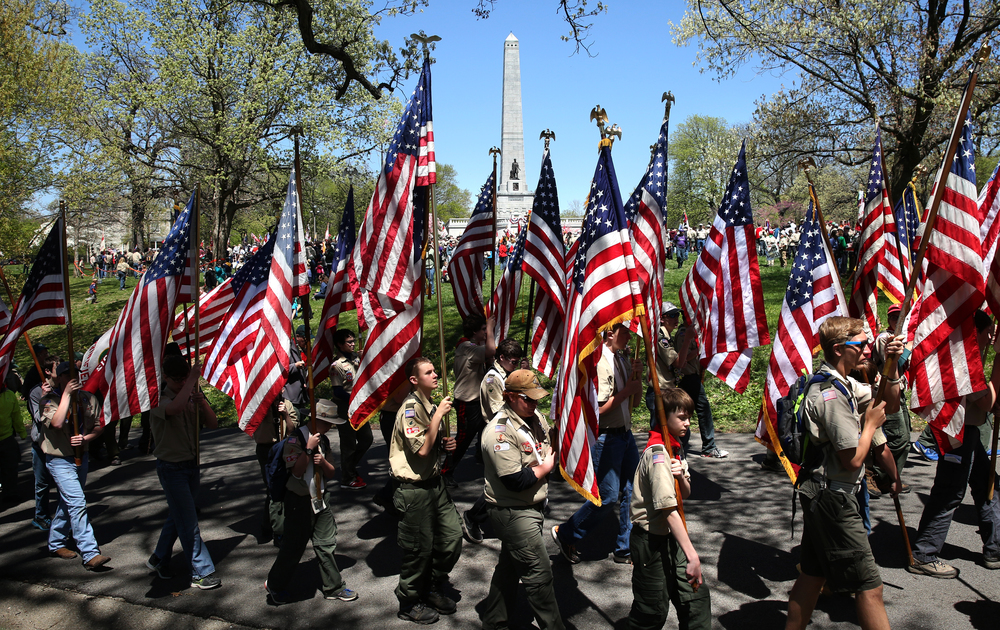Eagle Scout Honor Guard members each carry the U.S. flag past the Lincoln Tomb as they set out downtown Sunday afternoon. David Spencer/The State Journal-Register