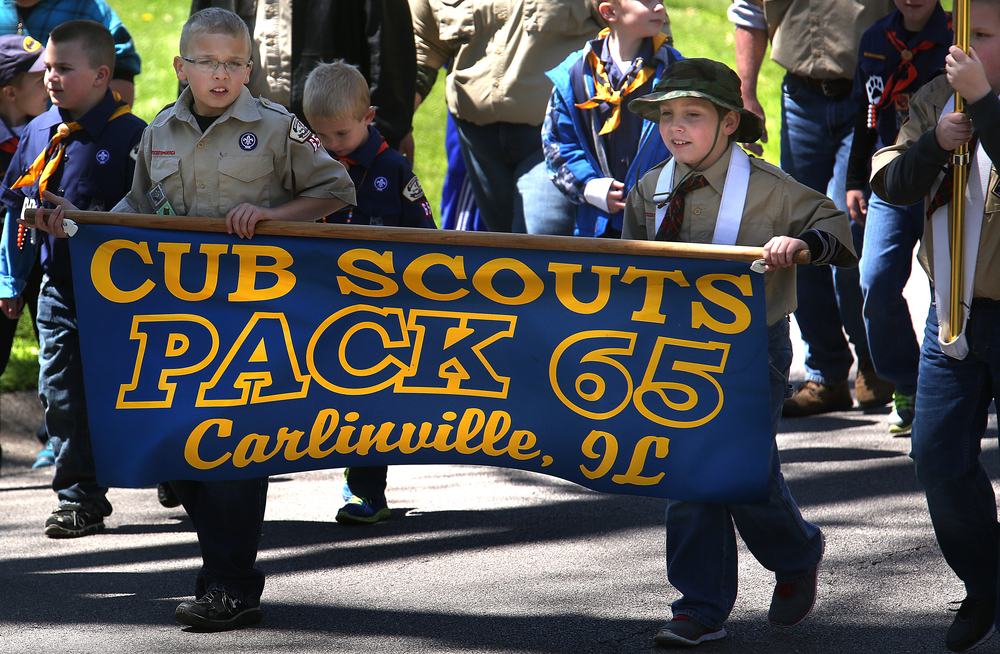Cub Scouts from Pack 65 in Carlinville set out for downtown outside the tomb Sunday afternoon. David Spencer/The State Journal-Register