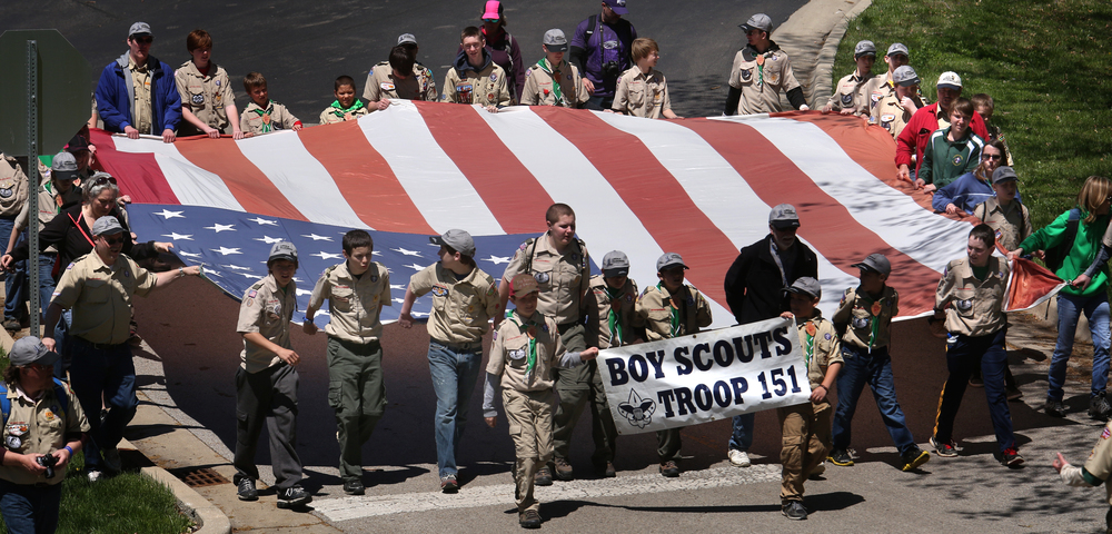 A large American flag is carried by members of Boy scout troop #151 from Algonquin, Ill who head for downtown outside the tomb Sunday afternoon. David Spencer/The State Journal-Register