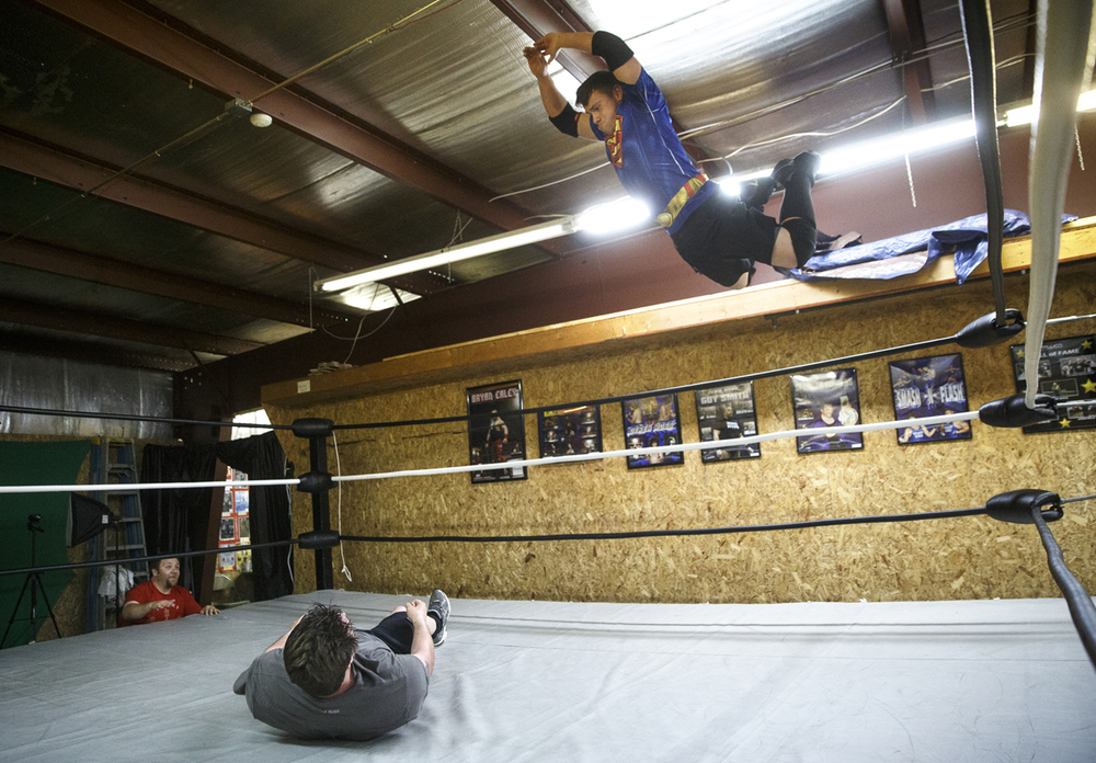 Kyle Warden flies off the top ropes and onto Shane Graham during a Pinfall Wrestling Association open gym session Thursday, April 16, 2015. Ted Schurter/The State Journal-Register
