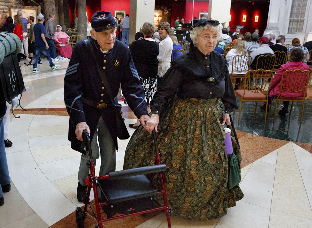 Roland and Marie Ann Hill walk through the Abraham Lincoln Presidential Museum during the museum's 10th anniversary celebration April 19, 2015. Roland plays piccolo with the 33rd Illinois Volunteer Regiment, which had performed during the event. Rich Saal/The State Journal-Register