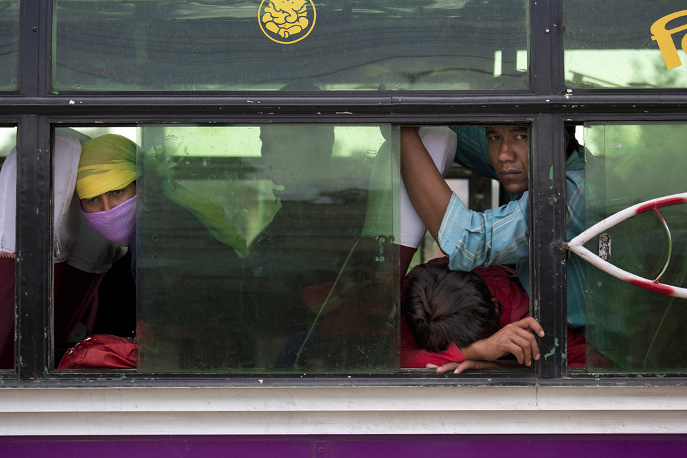 Because of the aftershocks, Nepalese people took shelter in a bus because it's considered safer than being inside buildings, in the Kalanki neighborhood of Kathmandu, Nepal, Sunday, April 26, 2015. A powerful aftershock shook Nepal on Sunday, making buildings sway and sending panicked Kathmandu residents running into the streets a day after a massive earthquake devastated the region and destroyed homes and infrastructure. (AP Photo/Bernat Armangue)