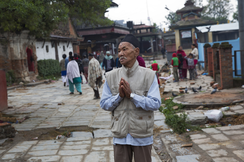 A Napalese man prays in Kathmandu, Nepal, Monday, April 27, 2015. (AP Photo/Bernat Armangue)