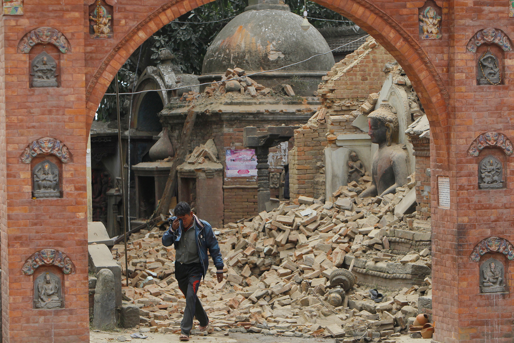 A Nepalese man cries as he walks through the earthquake debris in Bhaktapur, near Kathmandu, Nepal, Sunday, April 26, 2015. (AP Photo/Niranjan Shrestha)