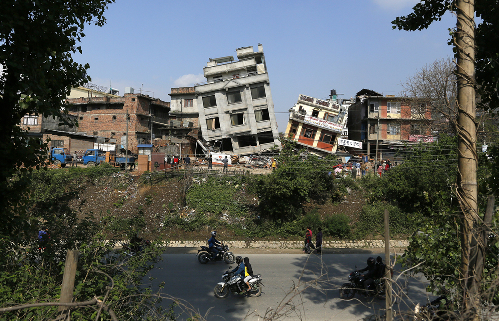 Damaged buildings lean to their sides in Kathmandu, Nepal, Monday, April 27, 2015. (AP Photo/Wally Santana)