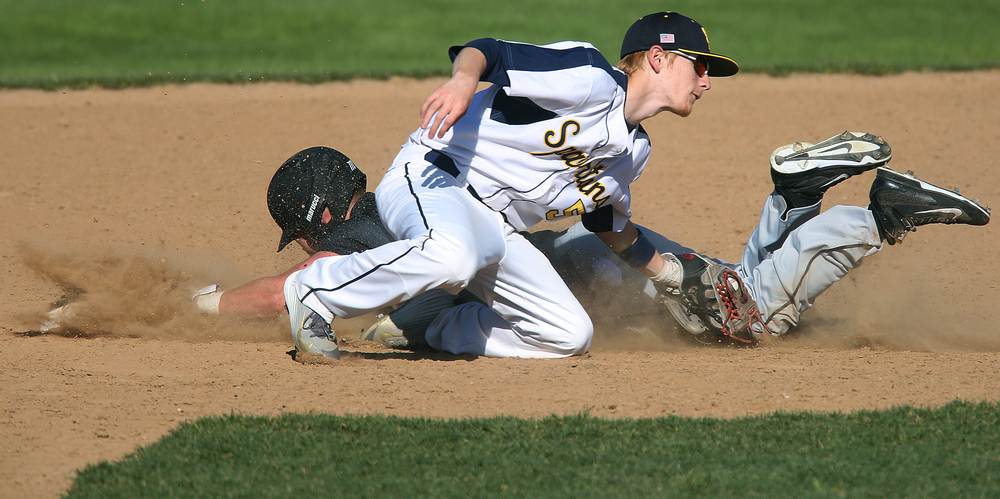 In 4rth inning action, Cyclones baserunner Sam Sergent is safe at second after evading the tag by Spartans player Anthony Clark. The Sacred Heart Griffin Cyclones defeated the Southeast High School Spartans 10-0 in the first game of the City Series Baseball tournament at Robin Roberts Stadium in Springfield on Monday, April 27, 2015. Cyclones pitcher Jack Staten earned the shutout victory. David Spencer/The State Journal-Register