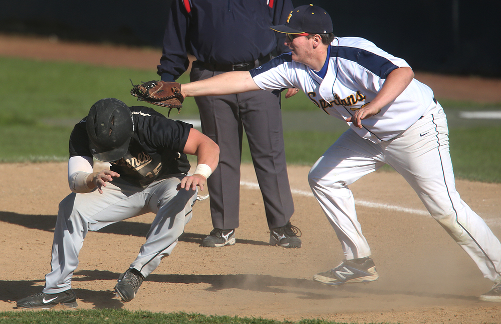 The Cyclones scoring streak eventually ended in the 4rth inning when baserunner Sam Sergent was tagged out in a pickle by Spartans first baseman Duncan Kirby. The Sacred Heart Griffin Cyclones defeated the Southeast High School Spartans 10-0 in the first game of the City Series Baseball tournament at Robin Roberts Stadium in Springfield on Monday, April 27, 2015. Cyclones pitcher Jack Staten earned the shutout victory. David Spencer/The State Journal-Register
