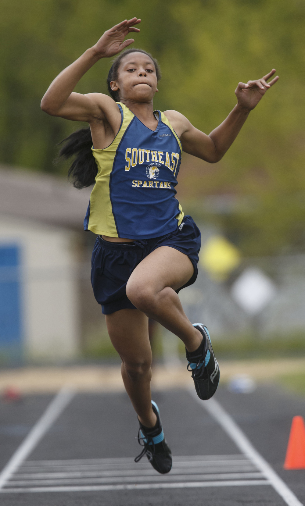 Southeast's Charlicia Watson competes in the triple jump during the 2015 Class AA Girls City meet at Southeast High School Wednesday, April 29, 2015. Watson won the event. Ted Schurter/The State Journal-Register