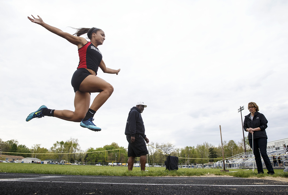 Springfield's Kyra Webster competes in the triple jump during the 2015 Class AA Girls City meet at Southeast High School Wednesday, April 29, 2015. Ted Schurter/The State Journal-Register