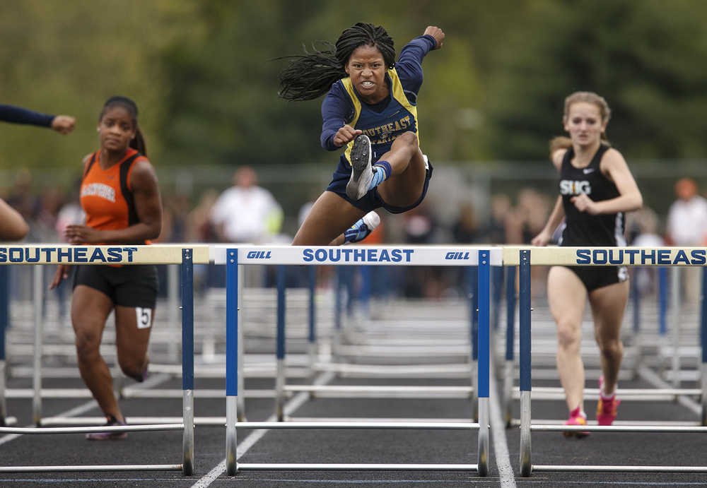 Southeast's  Dontavia Howard cruises over the last hurdle on her way to victory in the 100 meter hurdles during the 2015 Class AA Girls City meet at Southeast High School Wednesday, April 29, 2015. Ted Schurter/The State Journal-Register
