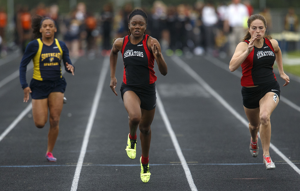 Springfield's Ozzy Erewele wins the 100 meter dash during the 2015 Class AA Girls City meet at Southeast High School Wednesday, April 29, 2015. Ted Schurter/The State Journal-Register