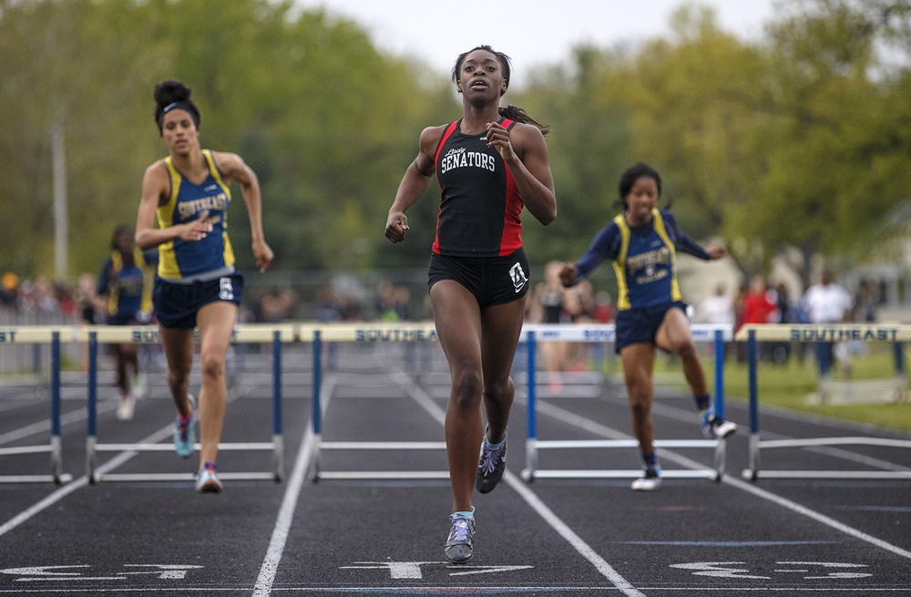 Springfield's  Ingrid Samuels wins the 300 meter hurdles during the 2015 Class AA Girls City meet at Southeast High School Wednesday, April 29, 2015. Ted Schurter/The State Journal-Register