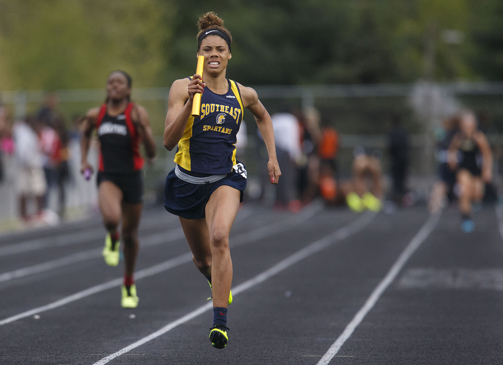 Southeast's Jamari Drake pulls away to win the 4x200 meter relay during the 2015 Class AA Girls City meet at Southeast High School Wednesday, April 29, 2015. Ted Schurter/The State Journal-Register