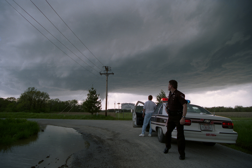Sangamon County Sheriff's deputies Wes Barr, right, and Pat Davlin watch the developing supercell from Cantrall Creek Road. Barr is now Sangamon County sheriff.