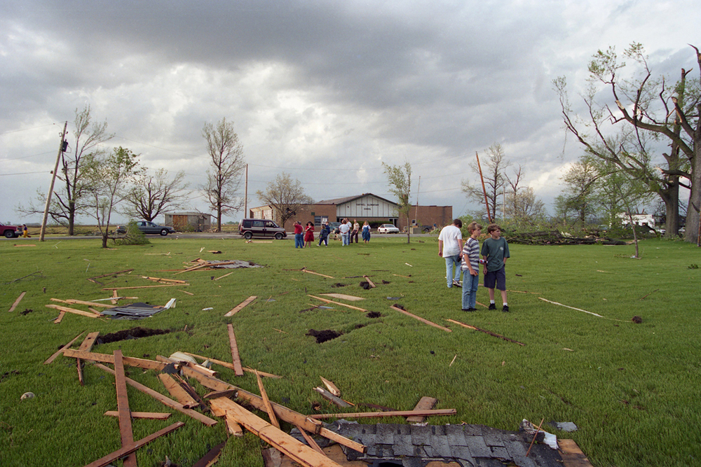 Residents take in the scene near the school after the storm.