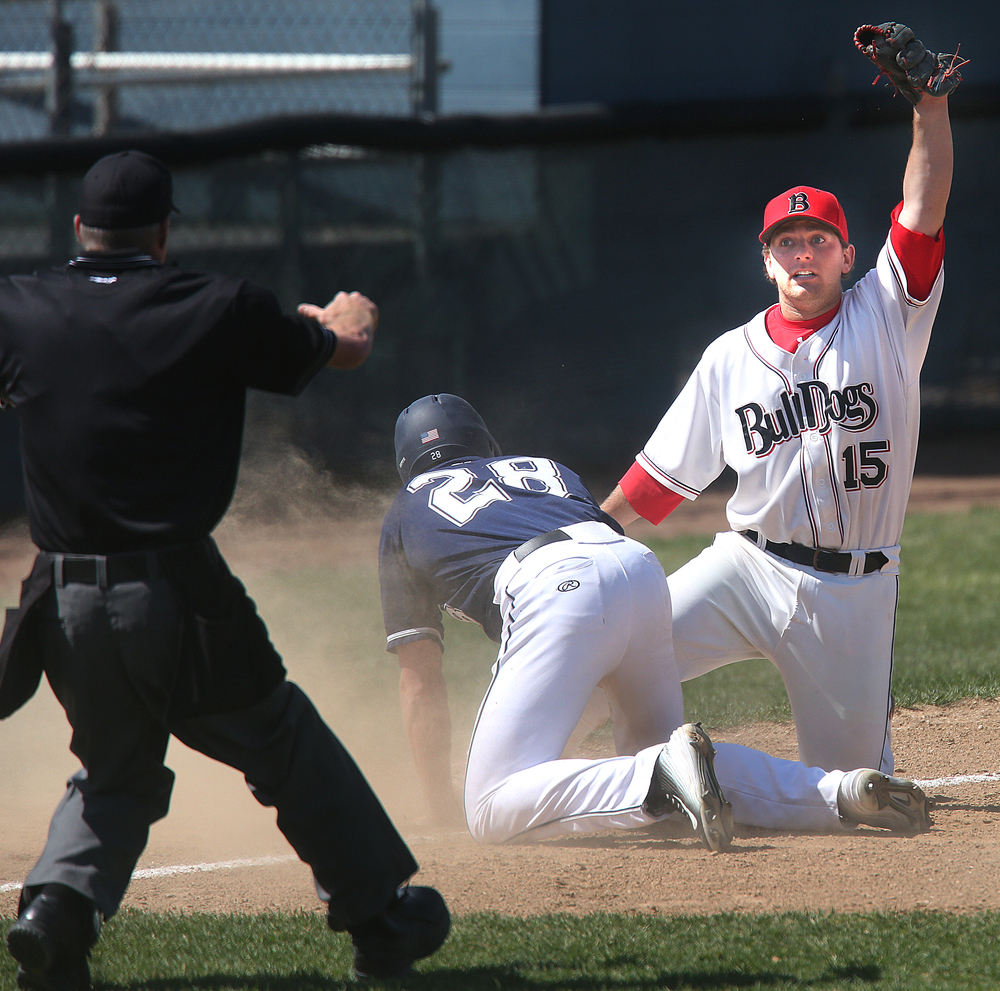 In fifth inning action, sliding Spartans baserunnerJared Hagely was safe while Bulldogs third baseman Blake Gand appeals to the upmpire. David Spencer/The State Journal-Register