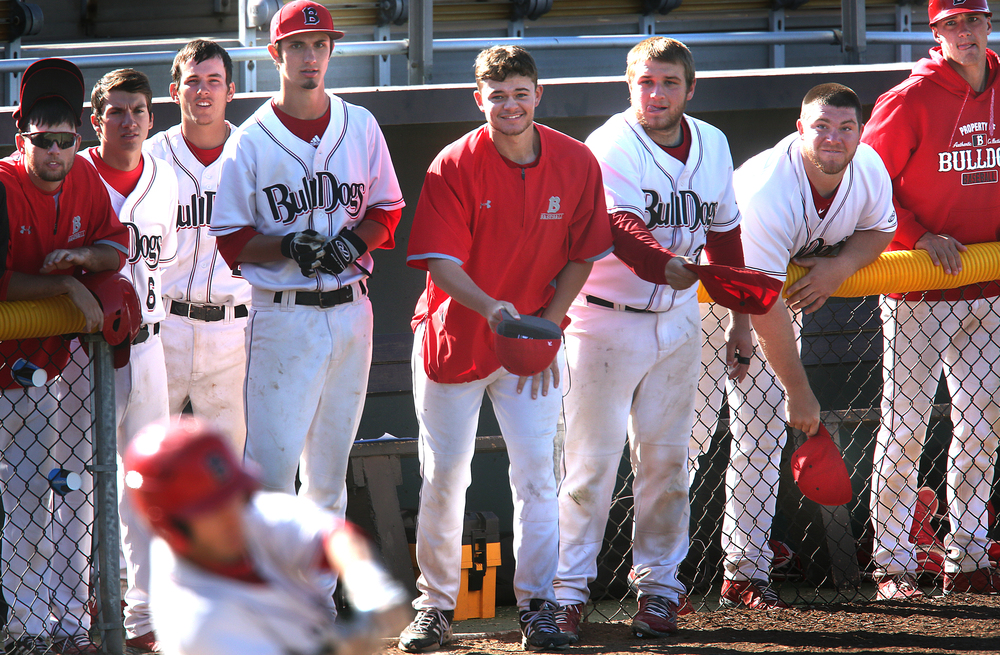The final ninth-inning batter for the Bulldogs was Chris Day, whose teammates were doing their best-including holding out their hats in the dugout-to give him good luck.  David Spencer/The State Journal-Register