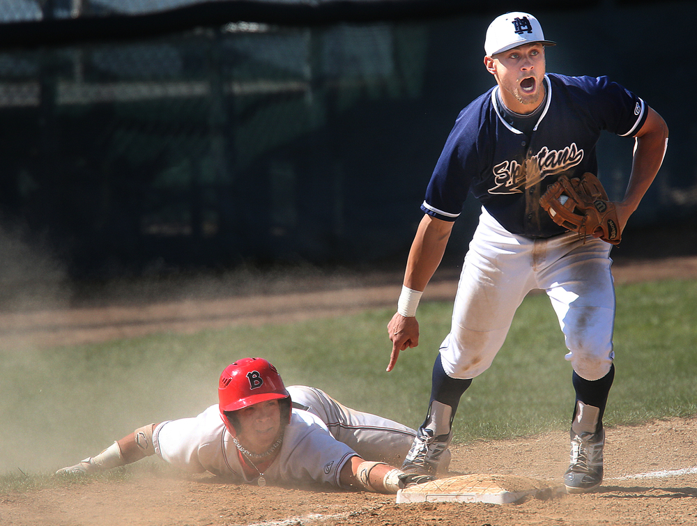 In sixth inning action, Bulldogs baserunner Edwin Covas is safe at third under the objection of Spartans third baseman Jeff Smith.  David Spencer/The State Journal-Register