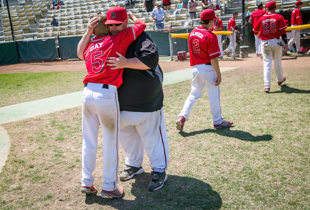 Benedictine head coach Steve Torricelli hugs senior Chris Day after the Bulldogs were defeated 10-7 by Williams Baptist during the American Midwest Conference Tournament at Robin Roberts Stadium, Friday, May 1, 2015, in Springfield, Ill. Justin L. Fowler/The State Journal-Register