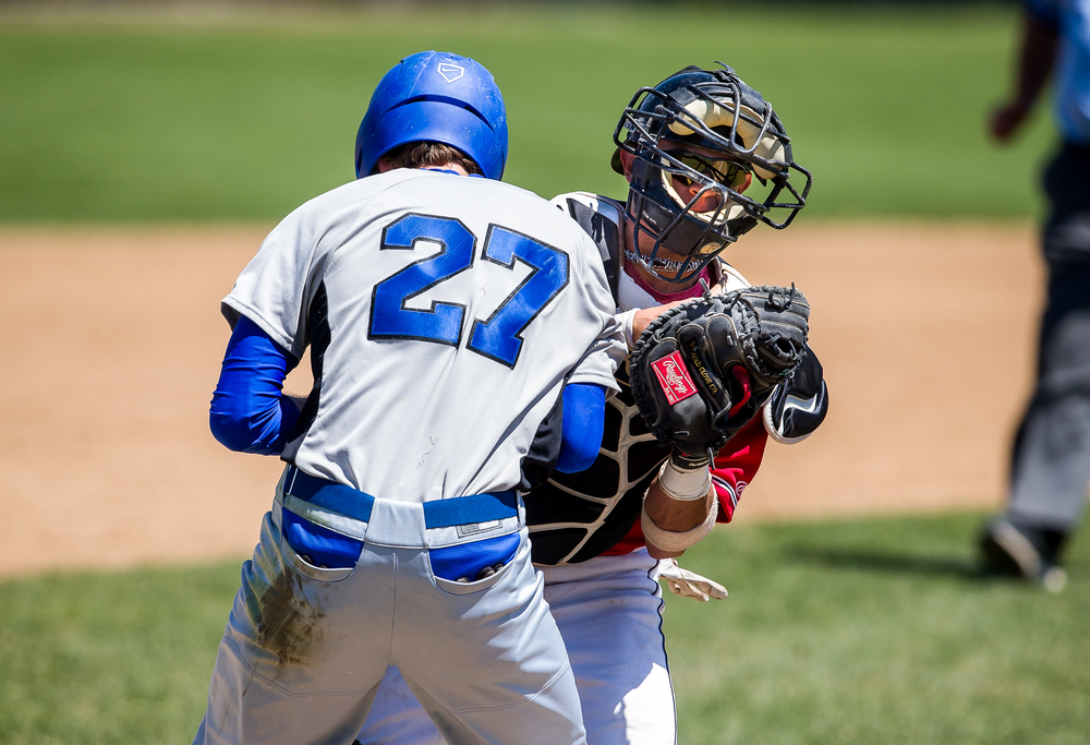Benedictine catcher Edwin Covas collides with Williams Baptist's Kagen Brown as he tags him out in a run down in the seventh inning during the American Midwest Conference Tournament at Robin Roberts Stadium, Friday, May 1, 2015, in Springfield, Ill. Justin L. Fowler/The State Journal-Register