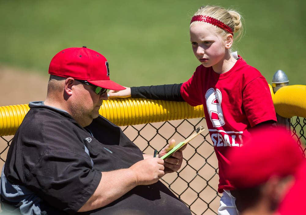 Benedictine head coach Steve Torricelli talks with his daughter, Olivia, as the Bulldogs take on Williams Baptist during the American Midwest Conference Tournament at Robin Roberts Stadium, Friday, May 1, 2015, in Springfield, Ill. Justin L. Fowler/The State Journal-Register