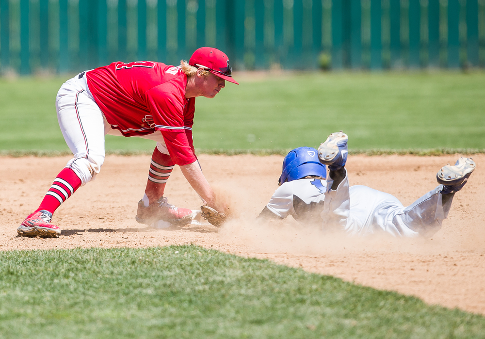 Benedictine second baseman Drake Hardin tags out Williams Baptist's Braxton Rhodes sliding in to second base in the fifth inning during the American Midwest Conference Tournament at Robin Roberts Stadium, Friday, May 1, 2015, in Springfield, Ill. Justin L. Fowler/The State Journal-Register