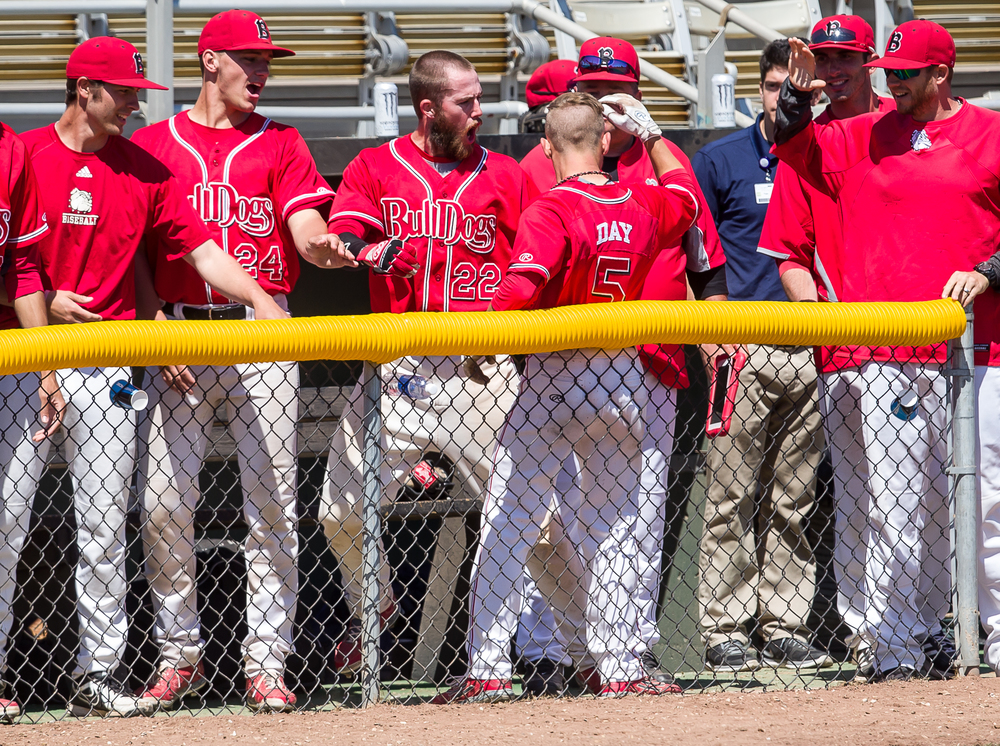Benedictine's Chris Day is congratulated by his team after hitting a solo home run against Williams Baptist in the third inning during the American Midwest Conference Tournament at Robin Roberts Stadium, Friday, May 1, 2015, in Springfield, Ill. Justin L. Fowler/The State Journal-Register