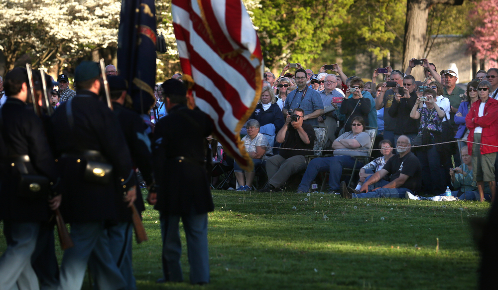 A large crowd watches during the presentation of the Colors. A flag retreat ceremony was presented by the 114th Regiment Illinois Volunteer Infantry (Reactivated) at the Lincoln Tomb in Springfield's Oak Ridge Cemetery on Friday evening, May 1, 2015. An extra large crowd by those from around the country visiting Springfield for the 150th Lincoln Funeral Weekend had perfect weather for the ceremony. David Spencer/The State Journal-Register