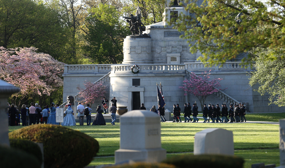 Flowering trees frame the procession of regimental marchers in front of the tomb who take their position at the beginning of the ceremony. A flag retreat ceremony was presented by the 114th Regiment Illinois Volunteer Infantry (Reactivated) at the Lincoln Tomb in Springfield's Oak Ridge Cemetery on Friday evening, May 1, 2015. An extra large crowd by those from around the country visiting Springfield for the 150th Lincoln Funeral Weekend had perfect weather for the ceremony. David Spencer/The State Journal-Register