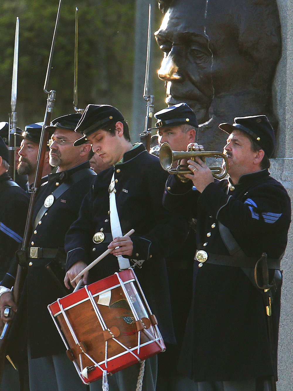A bugler and drummer from the regiment play during the ceremony. A flag retreat ceremony was presented by the 114th Regiment Illinois Volunteer Infantry (Reactivated) at the Lincoln Tomb in Springfield's Oak Ridge Cemetery on Friday evening, May 1, 2015. An extra large crowd by those from around the country visiting Springfield for the 150th Lincoln Funeral Weekend had perfect weather for the ceremony. David Spencer/The State Journal-Register