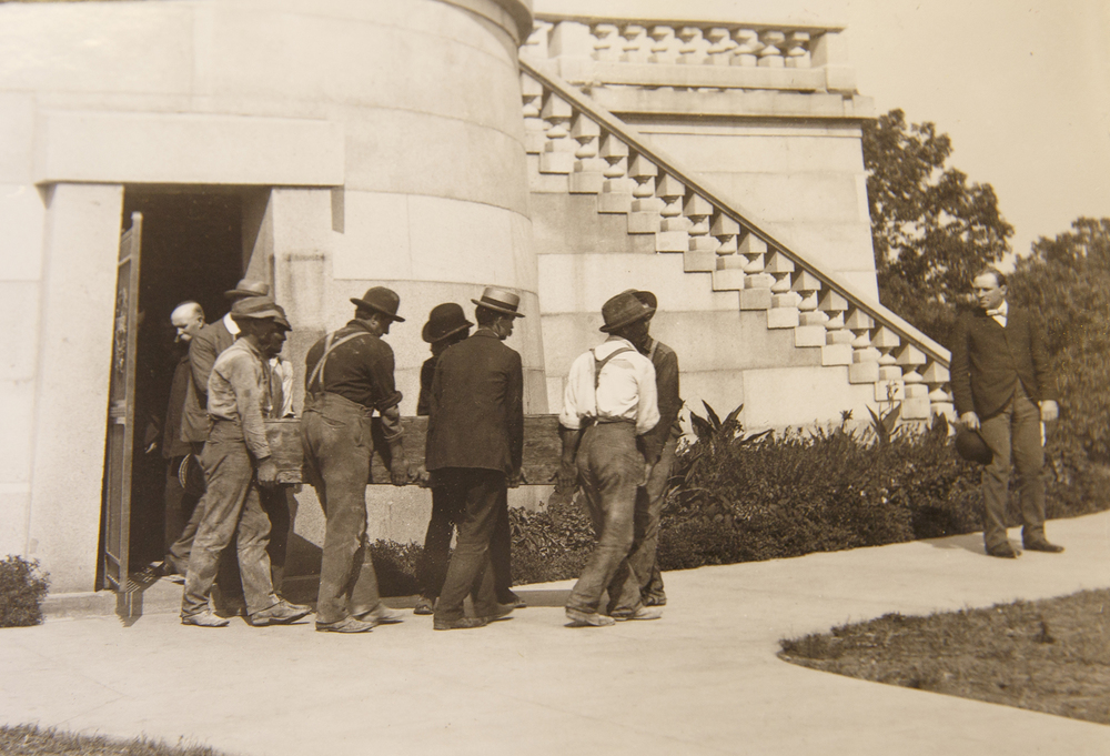 Workmen carry President Lincoln's coffin from the sepulcher room in the tomb after his coffin was opened and his identify was confirmed by a select group of people Sept. 26, 1901. Robert Todd Lincoln, the president's oldest and only surviving son, insisted on modifications to the redone vault during the reconstruction. After making the changes in the summer of 1901, which involved the addition of a steel cage and cement enclosure, the president's remains were moved for last time to their final place. Sangamon Valley Collection at Lincoln Library