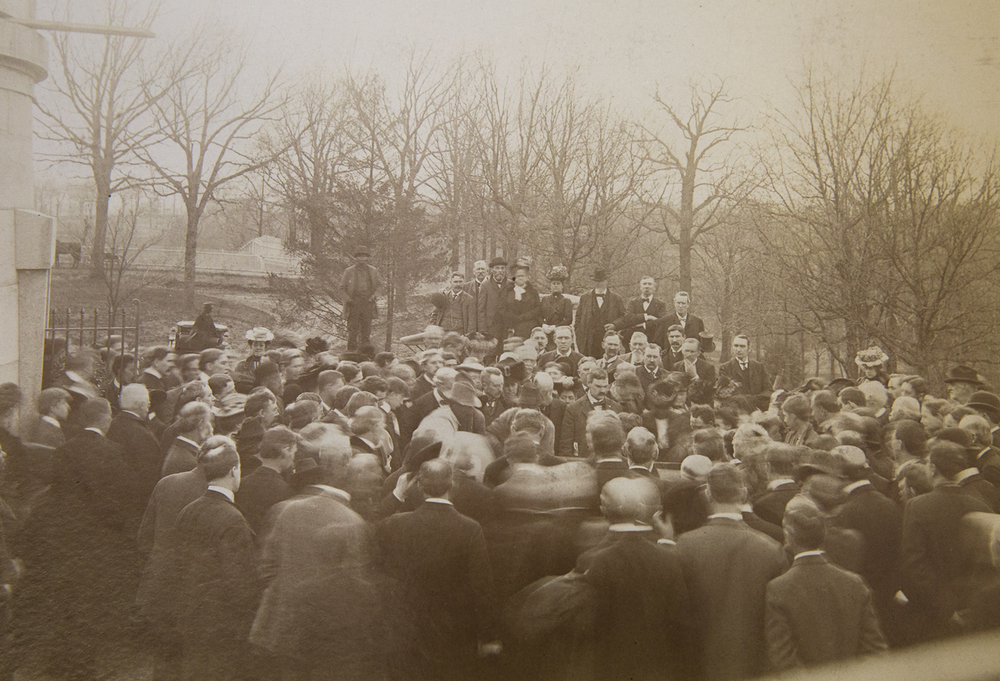 A crowd of spectators crowd around the temporary vault that held the Lincoln family remains when it was opened April 26, 1901 for transfer back to the tomb. Sangamon Valley Collection at Lincoln Library