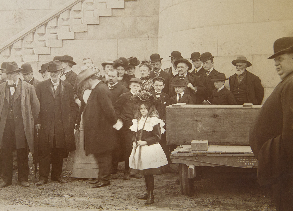 "Among the crowd to see the Lincoln family remains transferred back to the tomb April 26, 1901 was Josephine Remann Edwards, who as a girl was the ""little Jossie"" Lincoln was said to carry on his shoulders. Edwards is standing just behind the two boys wearing caps, center. Sangamon Valley Collection at Lincoln Library"