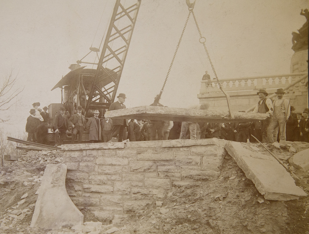 A large stone tablet is lifted off the temporary vault April 26, 1901 before the Lincoln family remains were transferred back to the tomb. Sangamon Valley Collection at Lincoln Library