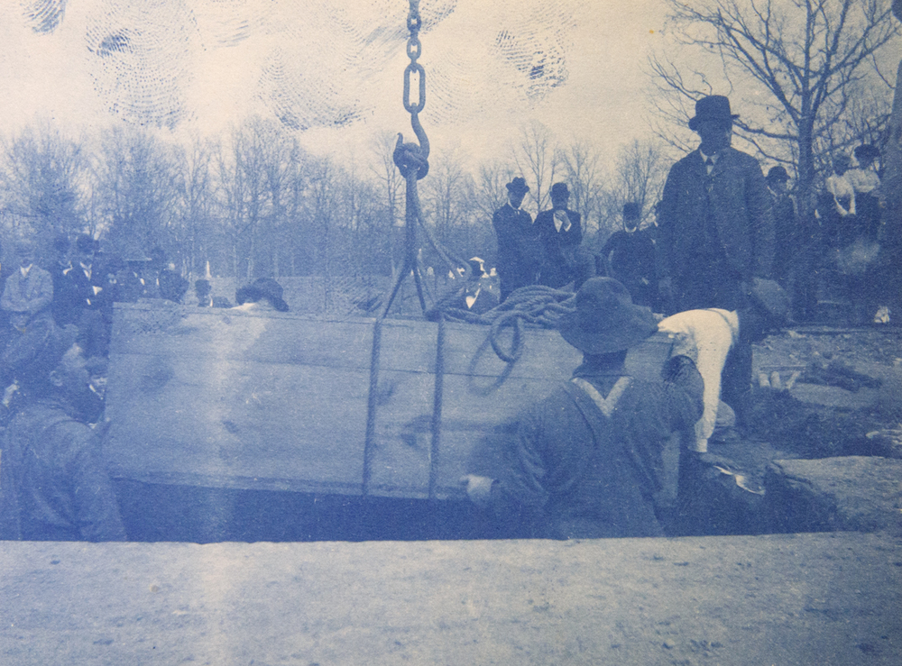 A child's coffin is lifted from the temporary vault April 26, 1901. John S. Stewart Collection/Sangamon Valley Collection at Lincoln Library