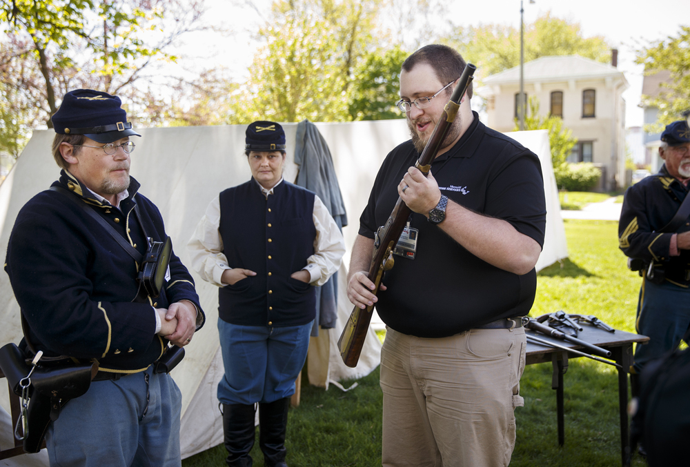 Andrew House examines an 1842 Mississippi rifle owned by Randy Weaver of Canton, Ill., a member of the 10th Illinois Volunteer Cavalry Regiment Reactivated, on the grounds of the Springfield Art Association Friday, May 1, 2015. Members of the regiment began camping on the grounds Thursday night in preparation for the 150th anniversary of Abraham Lincoln's funeral weekend. Ted Schurter/The State Journal-Register