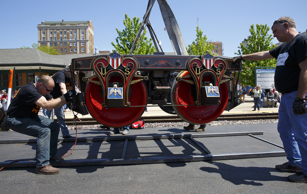 One of the wheel sets for the Lincoln Funeral Car are set in place at the Amtrak Station Friday, May 1, 2015, before they are moved under the train car. The full-scale, historically accurate car is re-creation of the one that carried Lincoln's body and that of his son, Willie, back to Springfield after his assassination, arriving at the same station in May 1865. The Funeral Car will be a part of the funeral re-enactment event this weekend. Rich Saal/The State Journal-Register