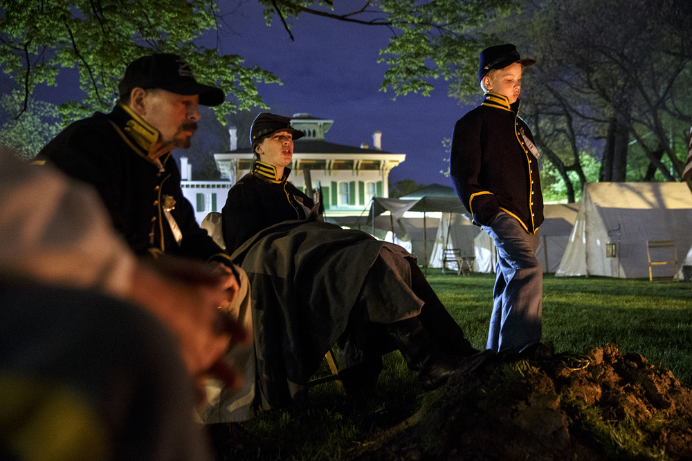 Members of the 10th Illinois Volunteer Cavalry Regiment Reactivated gather around a campfire on the grounds of the Springfield Art Association late Friday, May 1, 2015. Members of the regiment began camping on the grounds Thursday night in preparation for the 150th anniversary of Abraham Lincoln's funeral weekend. Ted Schurter/The State Journal-Register