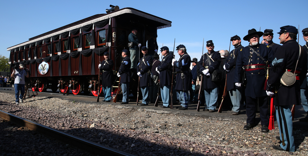 The Lincoln Funeral Car, a full-scale, historically accurate reproduction of the train car that carried Lincoln's body and that of his son, Willie, back to Springfield after his assassination, sits along the tracks near the Amtrak station Saturday at the start of the procession. Lincoln's funeral train arrived at the same station in May 1865. David Spencer/The State Journal-Register