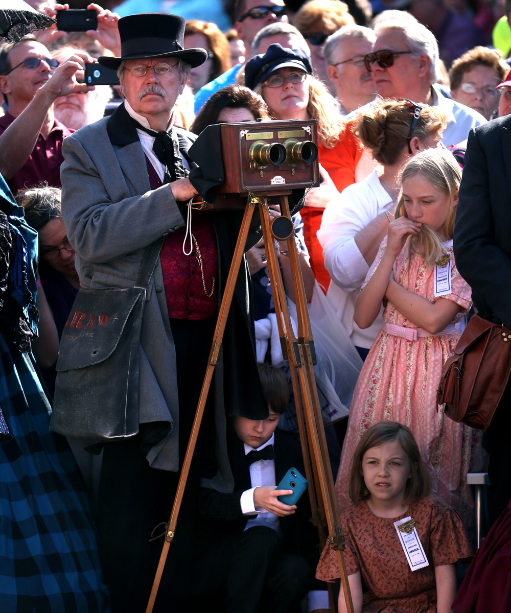 Photographer Robert Taunt, an historical re-enactor from La Crosse, Wis. representing the Mathew Brady Photographic Studio, used an authentic 1860 stereo camera to document the funeral procession Saturday. David Spencer/The State Journal-Register