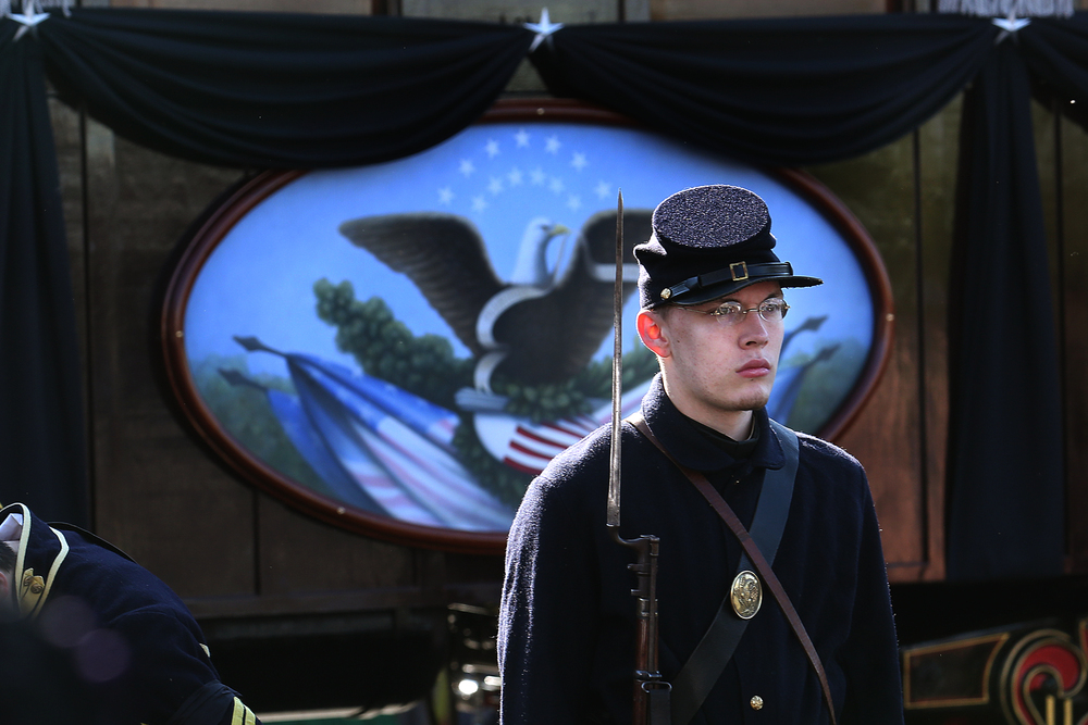 A re-enactor portraying a Union soldier stands at attention outside the train car Saturday. David Spencer/The State Journal-Register