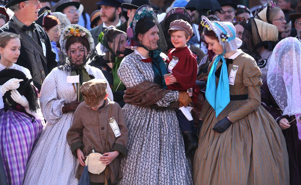 Hundreds of re-enactors dressed in Civil War era clothing stood outside the train station where the funeral procession began Saturday. David Spencer/The State Journal-Register
