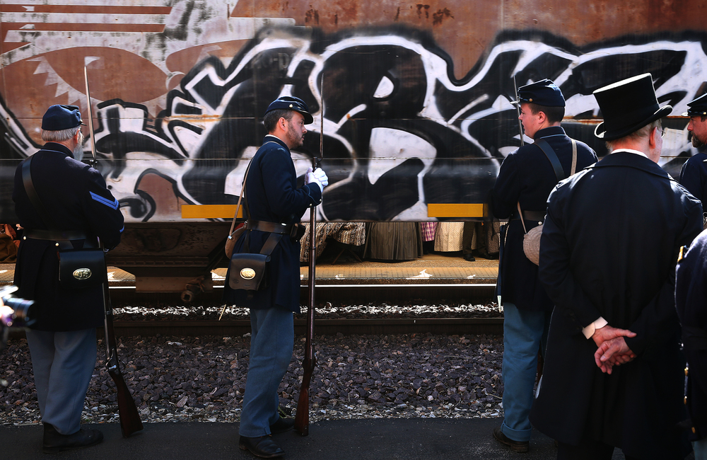 The funeral ceremony at the Amtrack station was delayed a bit by a passing Union Pacific freight train Saturday. David Spencer/The State Journal-Register