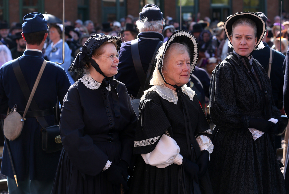 Re-enactors portraying Abraham Lincoln's family and friends wait outside the train station for the procession to begin. David Spencer/The State Journal-Register