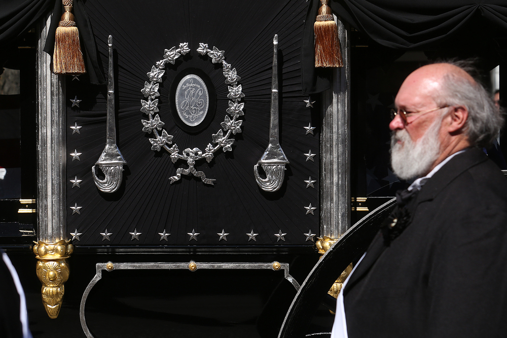 A close-up shows the side of the Lincoln hearse with inset silver replica medallion in middle during the funeral procession. David Spencer/The State Journal-Register