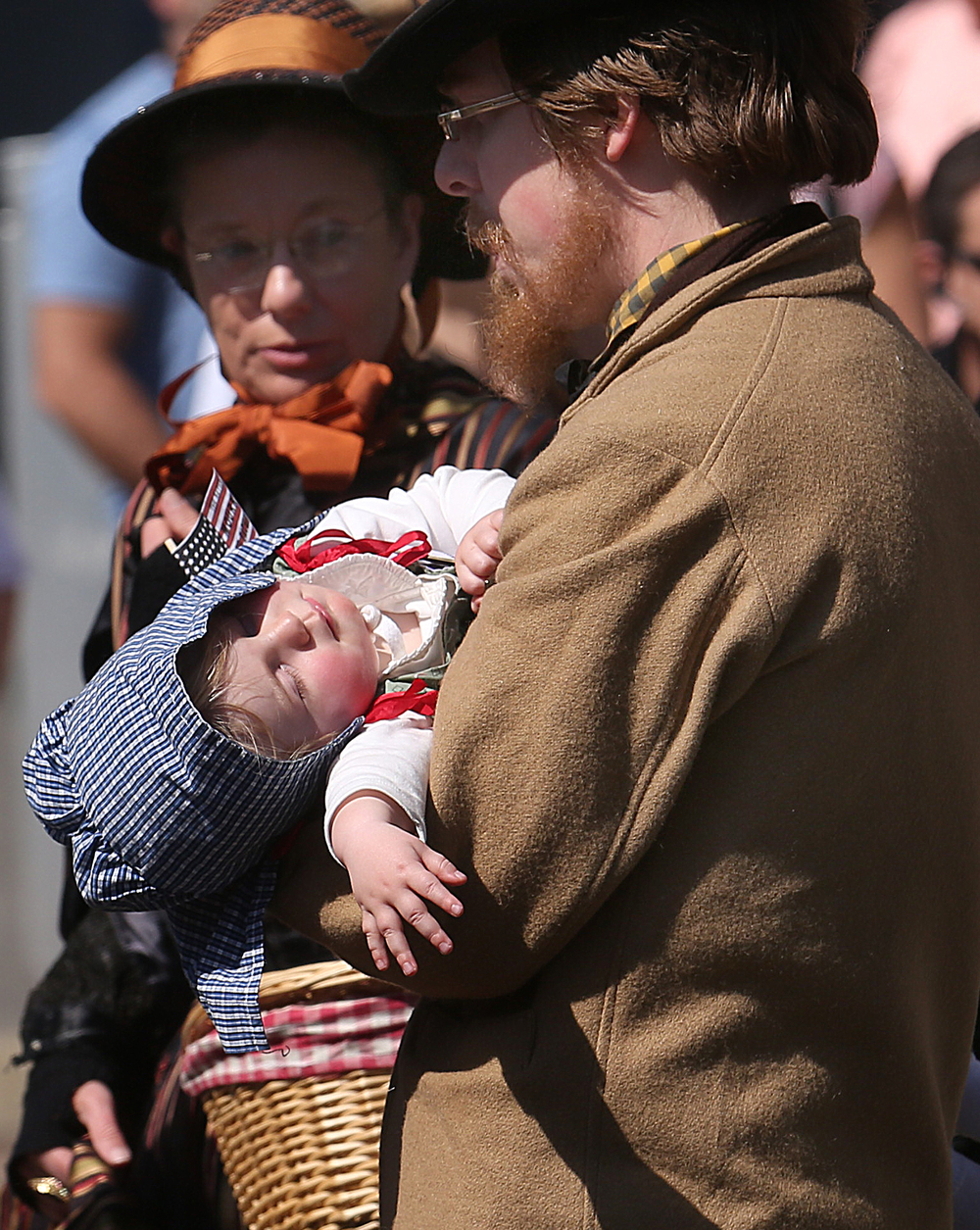 One participant in the funeral procession, a young child, appeared to be taking a nap while being carried down Fifth Street. David Spencer/The State Journal-Register