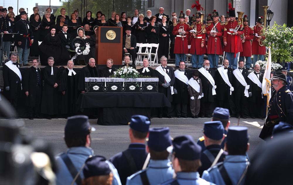 The casket of Lincoln was removed from the hearse and placed on a temporary bier in front of a large stage outside the Old State Capitol in downtown Springfield. David Spencer/The State Journal-Register
