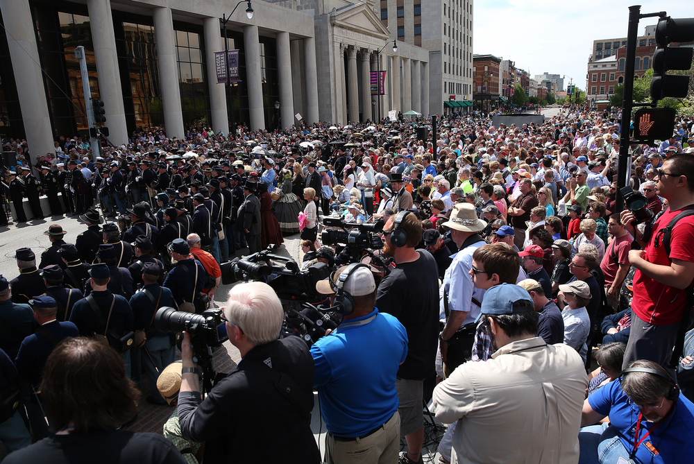An overall scene showing some of the thousands of spectators gathered outside the Old State Capitol along Sixth St. in downtown Springfield who listen during the funeral ceremony. David Spencer/The State Journal-Register