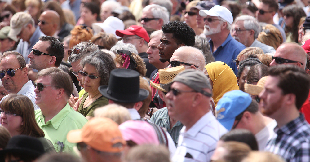 Spectators watch and listen during the funeral ceremony along Sixth St. in downtown Springfield. David Spencer/The State Journal-Register